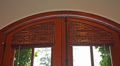 Arched Roman Shade valance to follow contour of door window.