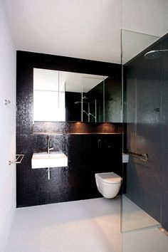 Bathroom , Simple Minimalist Bathroom Style : Minimalist Bathroom Black Mosaic Glass Tiles And Wall Mounted Toilet And Sink And Mirrored Medicine Cabinet And Shower Head