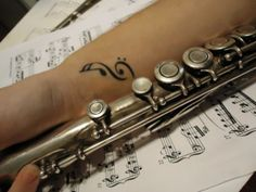 An homage to my love of tattoos and my former flute-playing days.