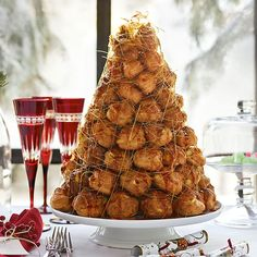 Croquembouche recipe and instructions (French Cream Puff Tower) held together with caramel and wrapped in spun sugar.