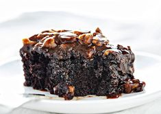 Dark Chocolate Cake with Buttermilk Pecan Frosting is a showstopper! Moist, flavorful, and basically a chocolate lovers dream come true! Buttermilk Chocolate Cake, Dark Chocolate Cakes, Chocolate Desserts, Chocolate Lovers, Buttermilk Frosting, Baking Recipes, Cake Recipes, Dessert Recipes, Frosting Recipes