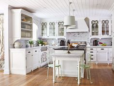 Suzie: Traditional Home - Gorgeous kitchen with groove ceiling, ivory glass-front kitchen ...