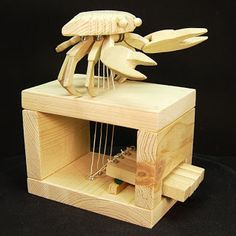 """This little guy is one of my very first attempts at """"automata"""". He was inspired by the blue crabs that we have fun catching when visiting . Kinetic Toys, Kinetic Art, Woodworking Toys, Woodworking Projects, Wood Crafts, Diy And Crafts, Mechanical Art, Magic Box, Handmade Toys"""