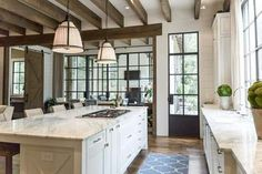 Love the open beam ceiling and dark panes on the windows and door #mykitchenvision