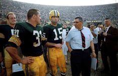 Green Bay Packers head coach Vince Lombardi with his players (from left) Paul Hornung ( Jim Taylor ( and Bart Starr ( during the final seconds of Super Bowl I versus the Kansas City Chiefs at the LA Memorial Coliseum. Green Bay Football, Green Bay Packers Fans, Packers Football, Nfl Green Bay, Football Memes, Greenbay Packers, College Football, Football Players, Bart Starr