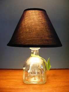 so i have dozens of bottles of patron, cant figure out the easiest way to cut the glass and attach the shade...ideas?