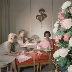 Gloria Vanderbilt receiving a manicure and pedicure at the House of Revlon, photographed by Horst P. Horst, ca 1961.