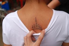 """Here's a submission from Pema, """"This is a sacred yant tattoo I got in Wat Bang Pra Thailand by a Buddhist monk. The design basically is a reminder to follow the Dharma (or the middle path), and prayers of protection are whispered into your back as they tattoo it with a large thin needle."""""""