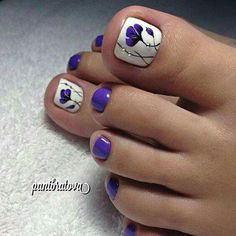 White and purple toenail design