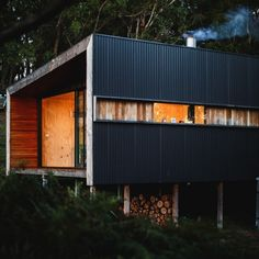 Box-Home-Design-with-Pump-Themed-Home-Design-Using-Black-Metal-Corrugated-Metal-Cladding-Combined-with-A-Little-Pretty-Orange-Color