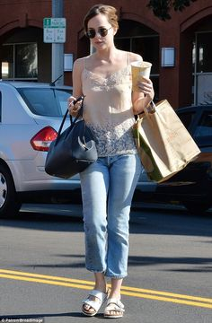 Sister act! Dakota Johnson and Stella Banderas mirror each other's style during a make-up free outing