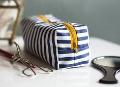 Isn't this boxy makeup bag by Say Yes adorable? It's large enough to hold makeup essentials, yet small enough to fit inside a medium sized purse. -Sewtorial