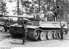 German tankers loading ammunition into a Tiger I heavy tank, near Lake Lagoda, northwestern Russia, Summer 1943 Photographer Zwirner Source German Federal Archive Identification Code Bild 101I-461-0213-34 Added By C. Peter Chen