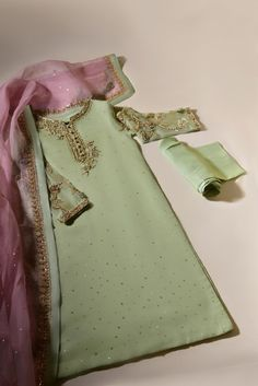 "Turn heads in "" Azaa "" like its name, Azaa is a vision to behold, rendered on pistachio green pure organza with delicate handwork details, paired with heavy teapink pure dupatta organza dupatta and matching raw silk trousers. The length of the kameez is 45 inches. Delivery Time: 6-8 Weeks Latest Dress For Girls, Stylish Dresses For Girls, Wedding Dresses For Girls, Simple Dresses, Beautiful Dresses, Simple Pakistani Dresses, Pakistani Wedding Outfits, Pakistani Dress Design, Pakistani Clothing"