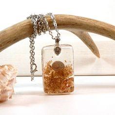 starfish sandollar seashell beach resin pendant - beach jewelry - shell necklace - sea jewelry - ocean pendant - eco friendly jewelry - sand by JolieGlace on Etsy https://www.etsy.com/listing/192578807/starfish-sandollar-seashell-beach-resin