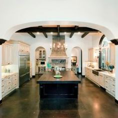 i like the layout and color palate of this kitchen