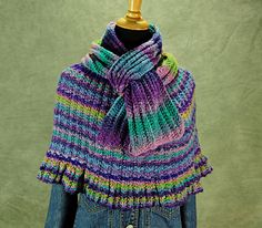 The capelet/poncho is worked in the round, from the bottom up, with no seaming required. It utilizes a stretchy, rib-based stitch pattern, that allows the garment to mold to multiple body sizes in just one simple version. It is as comfortable and easy to wear as any shawl, and makes an invaluable accessory piece suitable for year round wear. It's a simple knit, yet it creates a seemingly complex textured fabric. The stitch pattern is written and charted for ease of use. The scarf pattern…