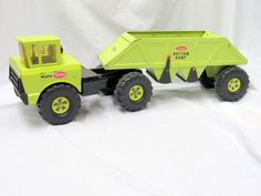 Showing very light play wear and no dents or rust. Both bottom doors are intact and working. This is the 1973 issue and the last year of production. The only issue is the hitch pin is missing and a screw has been placed in the trailer so that it can be hooked up. | eBay! Tonka Toys, Toy Trucks, Good Ole, Toys Shop, Classic Toys, Old Toys, Vintage Toys, Hot Wheels, Childhood Memories