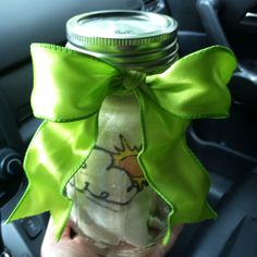Baby gift I packaged up in a Ball jar! Was able to fit two 6 month onesies in it (rolled them up neatly).  The jar can be reused.  You could even make a slot in the lid to turn it into a piggy bank....