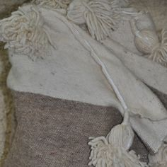 Pompom blanket w/be via Wallboe Interior. Click on the image to see more!
