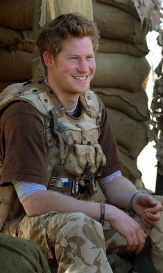 Prince Harry smiles as he sits at the observation post on JTAC Hill on January…