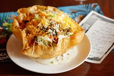 Taco salad at El Cortez, with ground beef, black olives, lettuce, cheddar, sour cream, tomato, and beans.