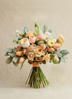 The Nouveau Romatics Peach Bouquet from Southern Living Weddings - heirloom roses, tulips, white tuberoses, peach yarrow, silverberry foliage