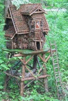 Pine cone and stick fairy house