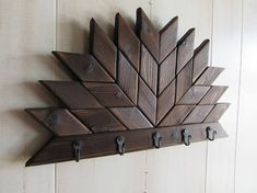 This Farmhouse Key/Leash Holder with rustic handmade hooks would be a amazing addition to your home! ●Each key rack comes with hangers ●Hooks are handmade in the USA These Barn Quilt Key Racks are made from pine wood, cut into indiviual pieces. Then the pieces go through a