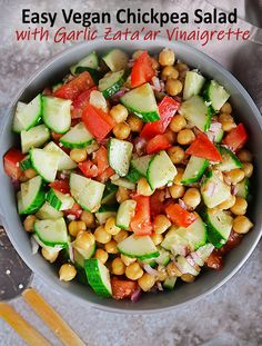 Chickpeas, tomatoes, red onion, and cucumber are enveloped in a garlic zata'ar vinaigrette in this tasty and easy vegan chickpea salad. Whip up a double batch of this salad for your next get-together. Or, prep it on Sunday and have a healthy side salad to enjoy at lunch for a couple of days. Atlanta Food, Healthy Salad Recipes, Delicious Recipes, Main Dish Salads, Chickpea Salad, Dinner Recipes, Top Recipes, Free Recipes, Evening Meals