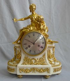 Antique French Ormolu And White Marble Louis XVIth Mantel Clock of Venus and Cupid Atop The Dome Top Of The Clock - France   c.1785 With The Movement And Dial  c.1820