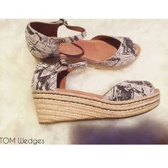 """BNWOT TOM Wedges Brand new without tags and box. Size 9. Fits true to size. Cute print in taupe and tan with 2.5"""" heel. Perfect for your spring wardrobe. Toms are known for comfortable shoes, so this is great for walking all day. **No TRADES** TOMS Shoes Wedges"""
