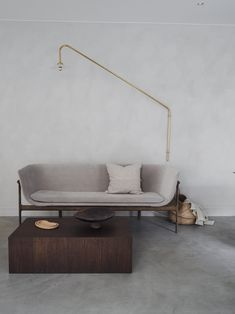 """Although most design lovers know Muller Van Severen for their furniture, the design couple's story actually kicked off with the conception of these hanging lamps. """"We were working in our new home which Modern Furniture, Furniture Design, Dining Bench, Entryway, New Homes, Brass, Couch, Interior Design, Lighting"""