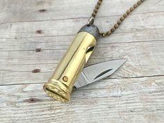 Bullet Knife Pendant Necklace Brass Bullet Casing Knife Necklace Bronze Bullet Charm Knife Necklace Bullet Jewelry Miniature Folding Knife by KaysvilleCraftSupply on Etsy https://www.etsy.com/listing/251508402/bullet-knife-pendant-necklace-brass