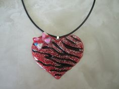 Wearable Resin Art Red Glitter Zebra striped Heart with Bow. $9.00, via Etsy.