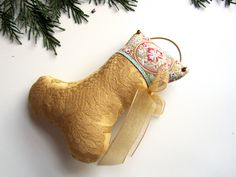 Gold damask stocking ornament with embroidered ribbon.
