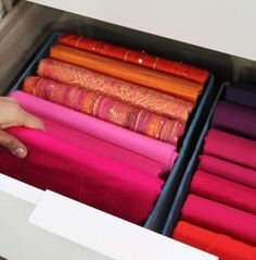 Wrapping your scarves around cardboard keeps them in great shape AND makes them fit nicely into a basket or drawer.