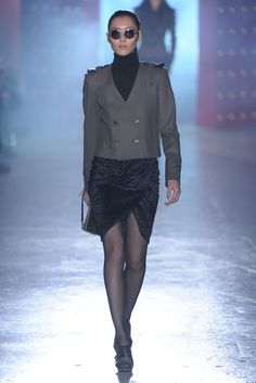 Jason Wu --- somehow between the round glasses, high neck, seductive skirt, and boxy military jacket...it works!