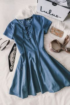 Your friends will try to uncover clues about where you might have gotten the Always Wonder Blue Chambray Lace-Up Skater Dress! Short sleeves frame a darted bodice with a lace-up neckline, while a woven skater skirt flutters below. #lovelulus