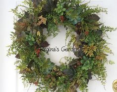 Spring Wreath-Fern Wreath-Rustic Greenery Wreath-Wreath for Door-Easter Wreath-Ivy Wreath-Rustic Wreath-Cottage Chic-Woodland Wreath  This natural looking wreath is designed with realistic looking ferns, seeded eucalyptus, ivy and jasmine. Winding vines with coral berries and cascading chartreuse-flowered vines add a light and lovely touch of color to this nature-inspired wreath. A birds nest with speckled eggs is nestled into the greenery. A simple cream canvas bow adds an understated…