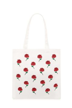 6a33eb7641ad A canvas tote bag featuring repeated rose print on the front and dual  shoulder straps.