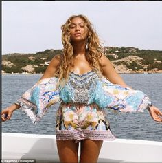 Ole! Beyonce wore a floral romper as she posed on a yacht in the Mediterranean in a photo shared on Friday on her site