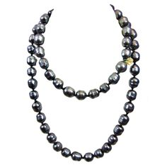Chanel Gunmetal Baroque Pearl Necklace, 1981   From a unique collection of vintage rope necklaces at http://www.1stdibs.com/jewelry/necklaces/rope-necklaces/