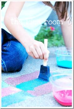 DIY sidewalk paint using water, cornstarch & food coloring. My boys will love this. Today we have a break in the rain, they are itching to play outdoors, this will be perfect. Their artwork will wash away & they can paint new masterpieces tomorrow!