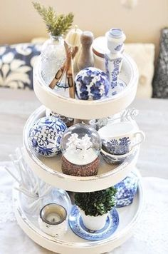 I wrote in my white vase challenge post several weeks ago about there being certain pieces of home decor that I would consider to be staples. I mentioned how the white vase would be one of those items. Well, the tiered tray would be another that is absolutely at the TOP of my list. Tiered