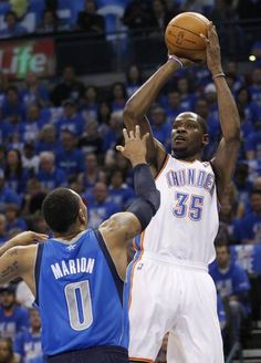 Playoffs! Oklahoma City Thunder forward Kevin Durant (35) shoots over Dallas Mavericks forward Shawn Marion (0) in the first quarter of Game 1 in a first-round NBA basketball playoff series in Oklahoma City, Saturday, April 28, 2012. (AP Photo/Sue Ogrocki)