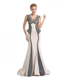 is on you, so wear a dress that no one will be expecting and steal the show.  Sheer illusion detailing on both the front and the back of the bodice gives this full length dress a shimmery and regal effect that will look amazing in that prom picture you've