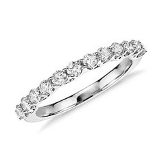 This platinum diamond ring showcases a 1/2 carat of prong set diamonds with a unique and stunning side profile.