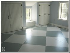 Inexpensive solution for flooring: painted pattern directly onto the subfloor. It is sealed with poly and has held up very well, even with two young boys.