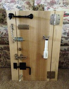 Latch board for Ethan. The door opens when all locks and latches are undone.